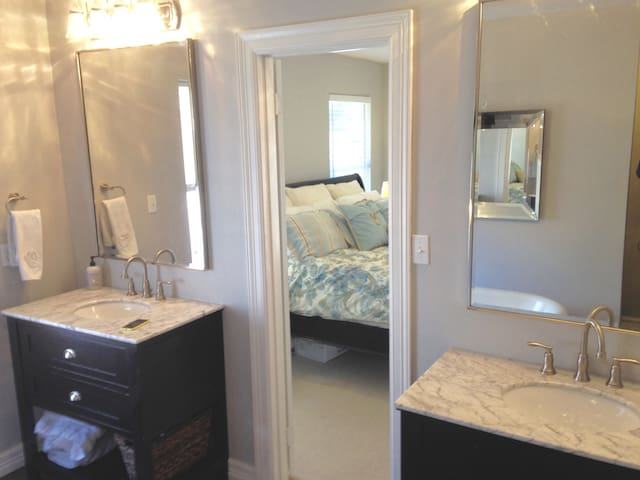 Updated Master bathroom, granite counter tops, stand alone tub with chandelier and stone shower.