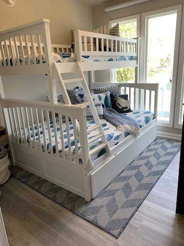 Bedroom 1: bunkbed is a twin over full with a twin trundle