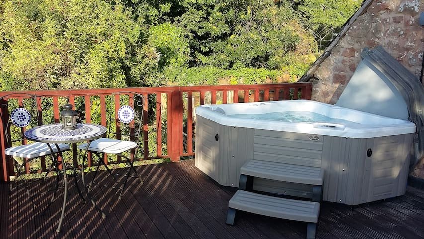 The private hot tub on the balcony with panoramic views across open countryside