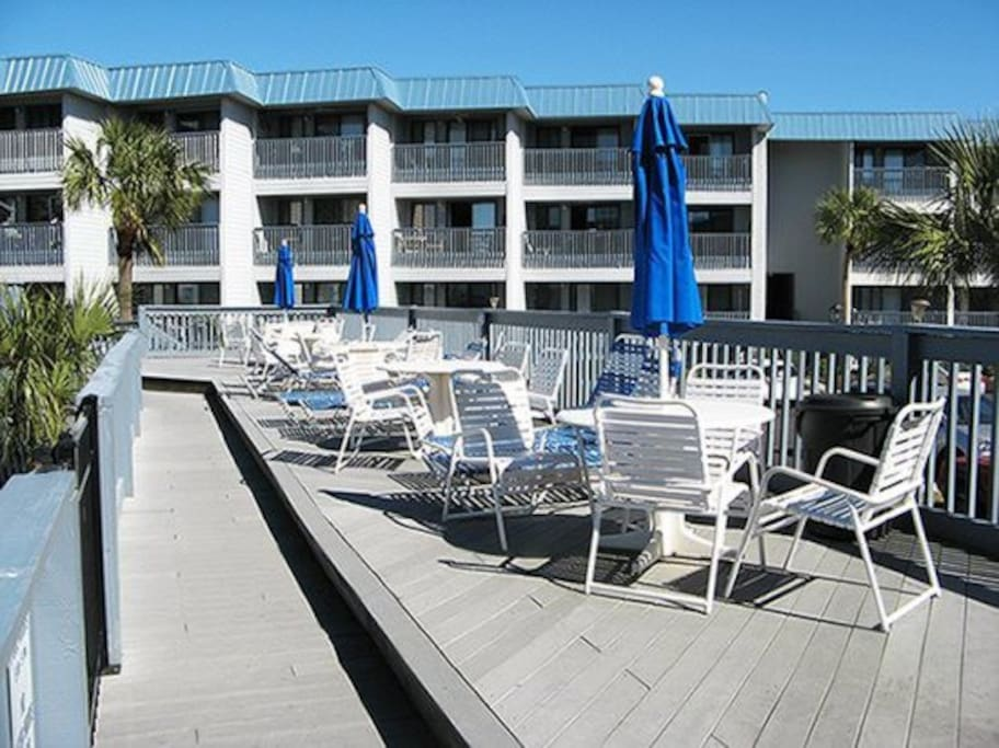Full Size Swimming Pool, a Wading Pool for the Young Ones, Lots of Tables and Chairs for Just Hangin` Out