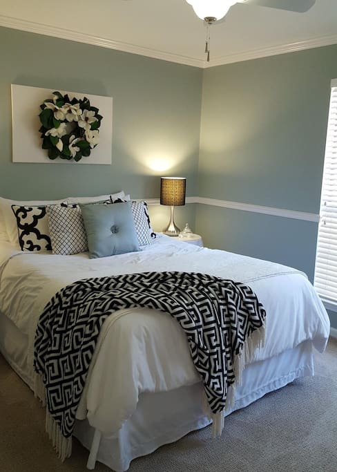 The guest bedroom has a comfortable queen size bed and enjoys lots of natural light. It's a calming, peaceful retreat!