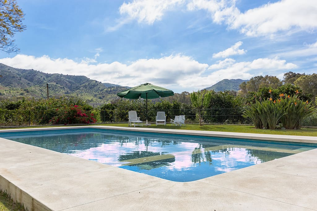 Huge private pool with intergated children´s pool surrounded by lawns and great views.