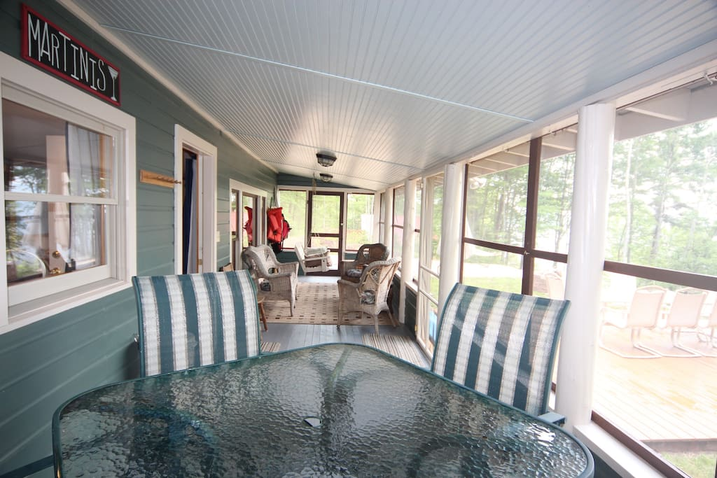 The screened-in porch will quickly become your favorite room in the cottage to relax and visit with your travel companions.