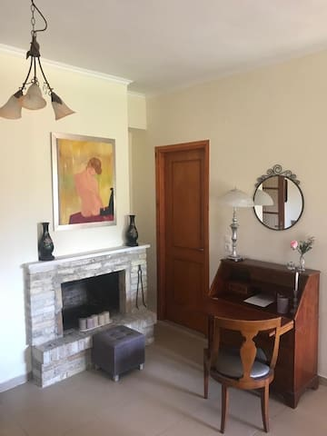 Our fireplace and a vintage working desk. The door is leading to the main bathroom