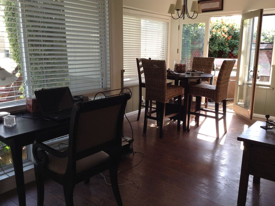 Dining area looks out to patio with BBQ