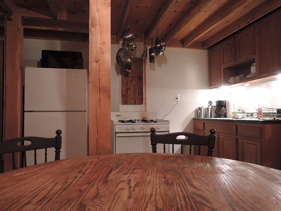 Kitchen with pots and pans, utensils, dishes, glassware, microwave, toaster, and coffee maker