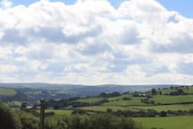 A view from the Apple green tent, across to the Denbigh Moors & Llyn (Lake) Brenig