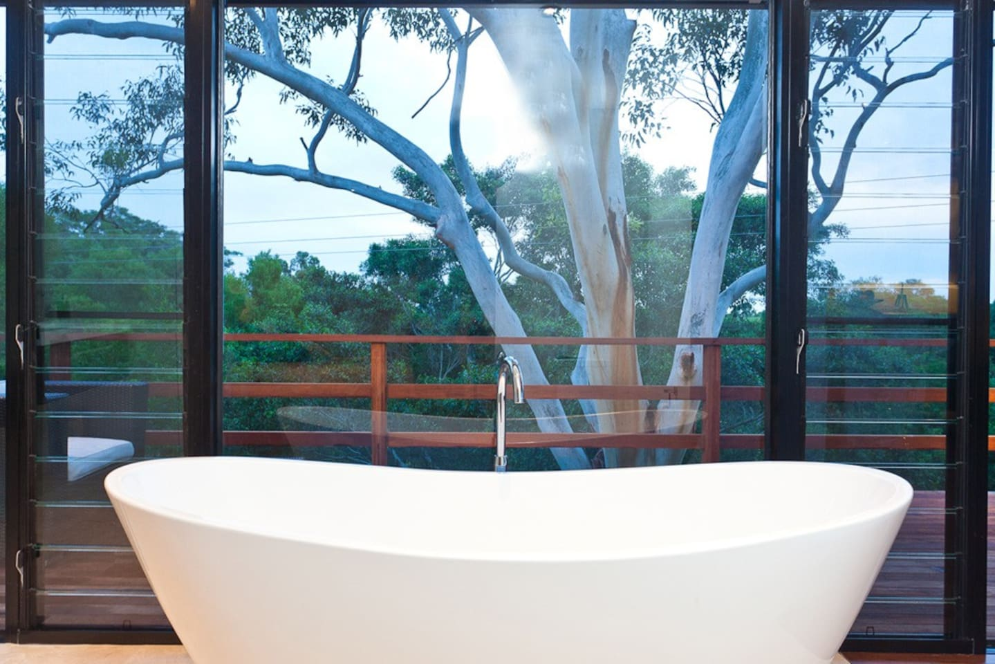 Luxurious relaxing bath with views of the hinterland
