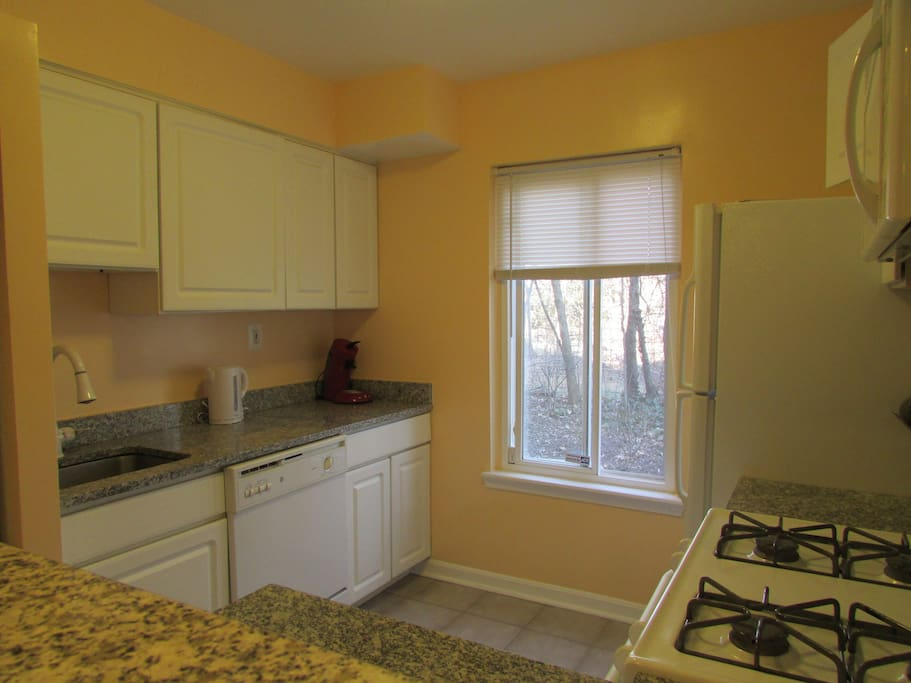 Newly renovated full kitchen with washer/dryer in closet.