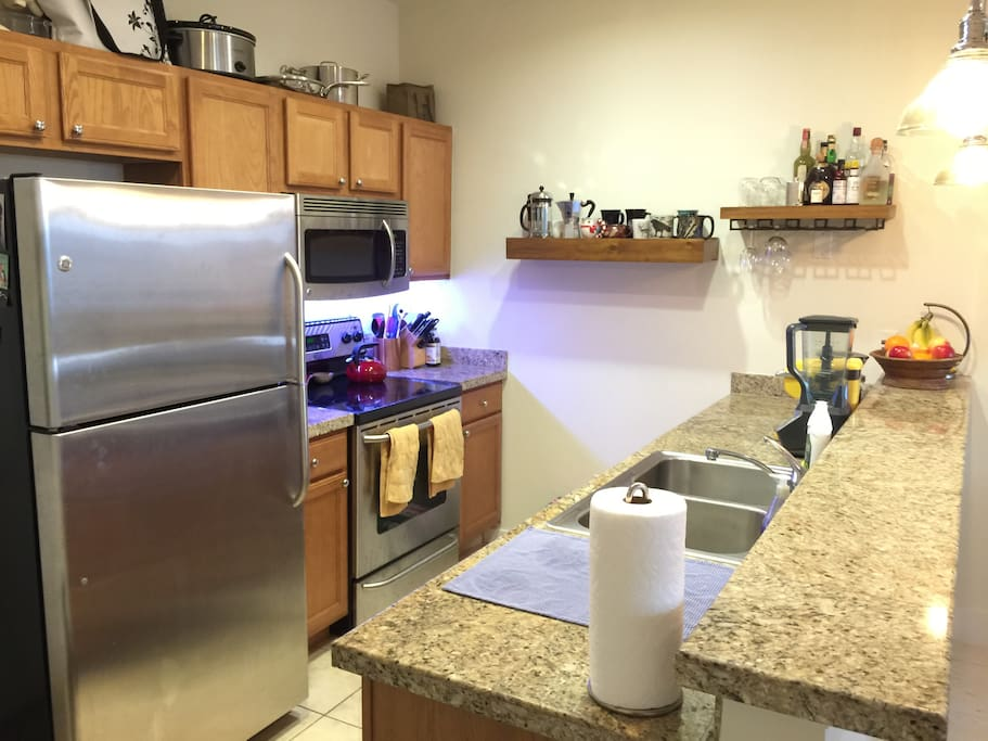 Kitchen with Keurig machine, coffee grinder, french press, Bialetti, and blender