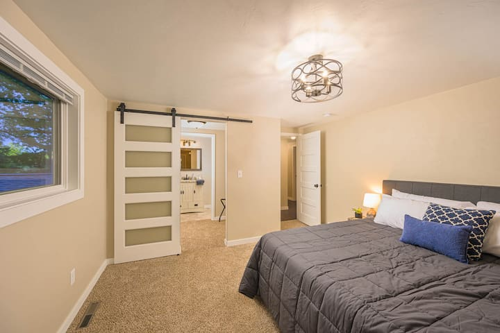 Master bedroom suite with brand new king bed, full bathroom, and second sitting deck.