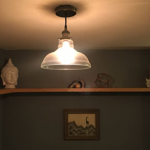 Edison bulbs give soft lighting in living room during the evenings.