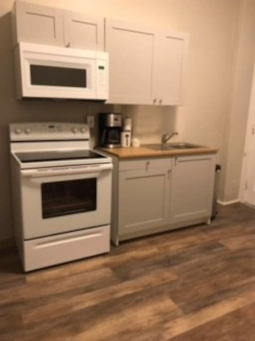Wonderful! Complete! Brand new kitchen just  installed with stove and microwave! New Flooring! Come and Enjoy!