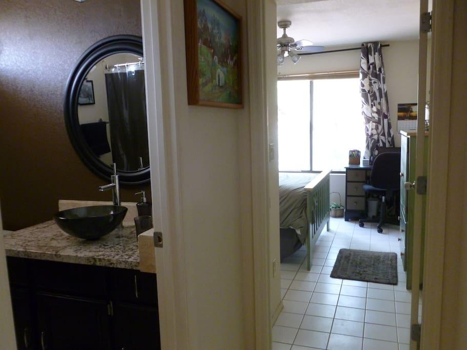 Guest wing.  Bathroom has granite, vessel sink, shower with seat, toilet.