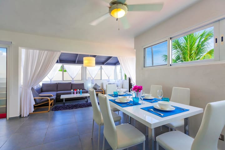 Luxury dining area. Here you'll have a big table for 6 persons, spacious kitchen with different kitchen utensils, ceiling fans!