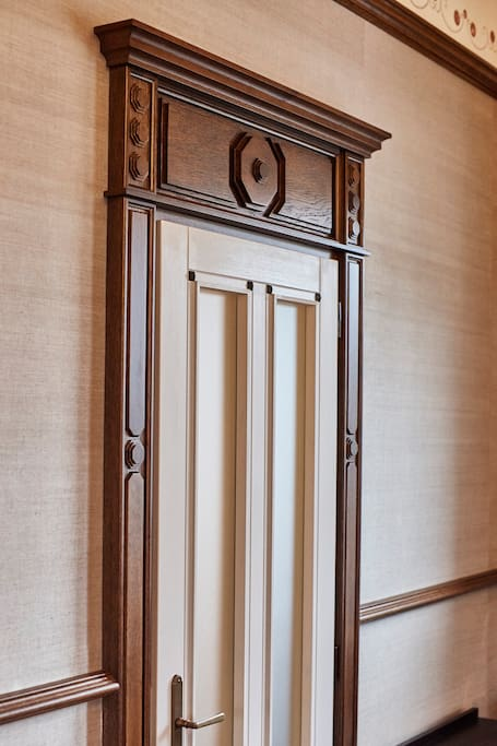 Every door is handmade, carved uniquely of solid wood