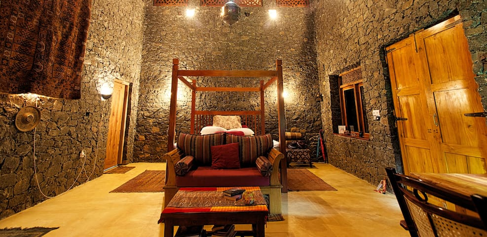 The large main room in Temple Bungalow with the big super thick King Size bed for the best sleep ever in the peaceful and quiet mountain air.
