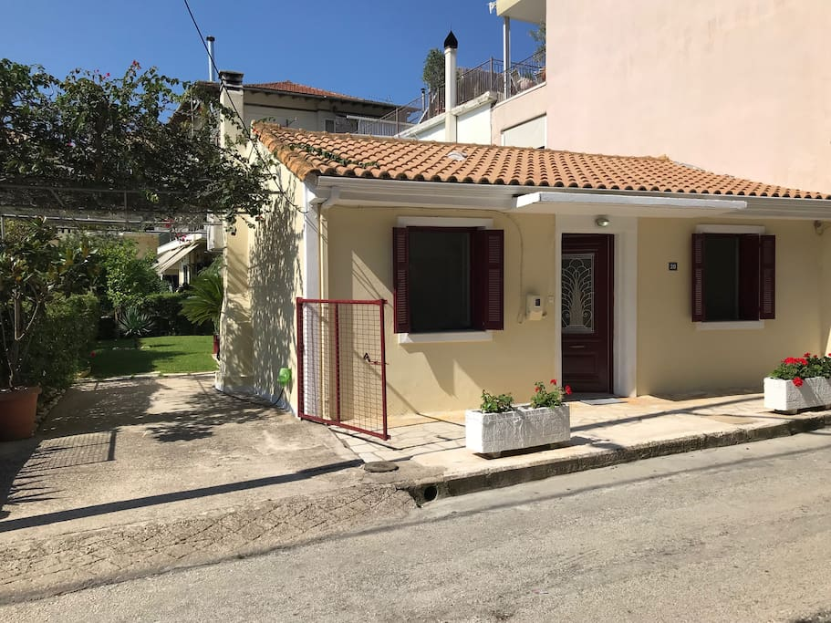 A traditional family summer house with a courtyard parking space and a beautiful garden on the back in the central area of Lefkada island