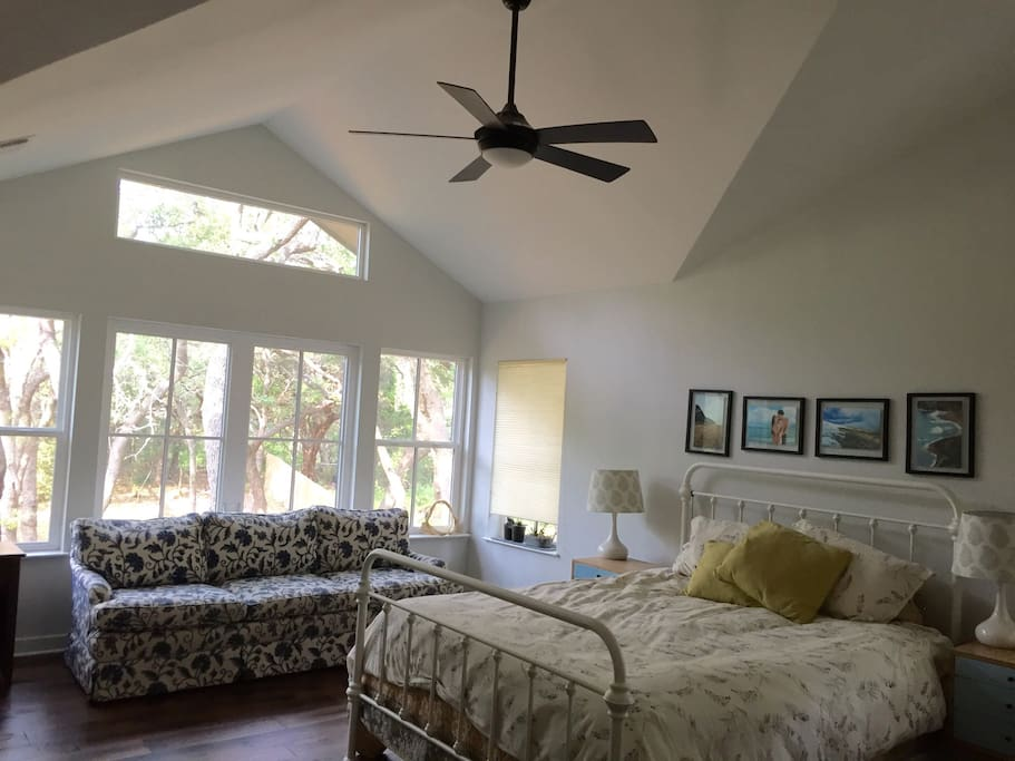 Master bedroom with cathedral ceiling and so much natural light from all the windows