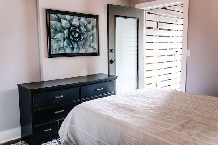 Bedroom with access to your private back patio.