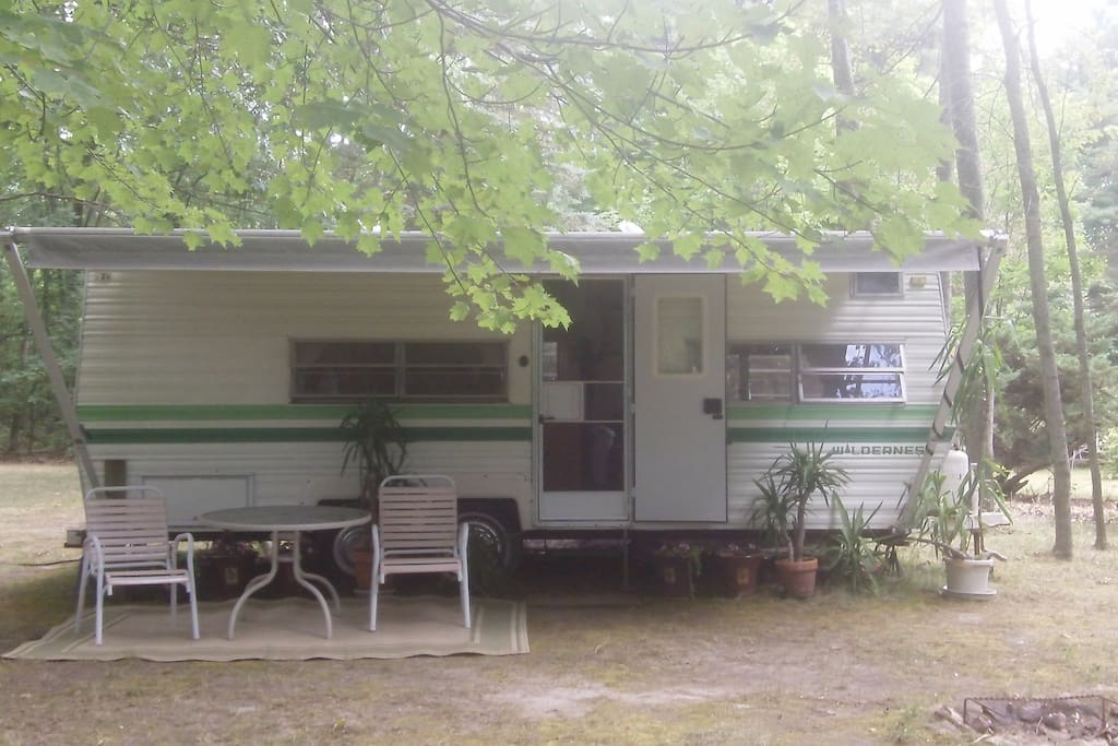 Gentle breezes blow through this RV from the lake. Meditation garden in the back and stairs down to the lake in front where the boat is. You have a private little drive that allows you to pull right up to the RV so you can leave some things in your car if
