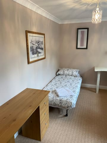 Second bedroom on 1st floor - single sofa bed with desk if needed. Enough space for additional cot if wished (not supplied.) Access to family bathroom on this floor.