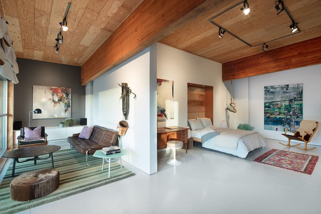 Eclectic in style, this roomy artist loft is a mix  of mid-century modern and raw industrial style. Artwork is displayed is all areas of the loft and is frequently updated.