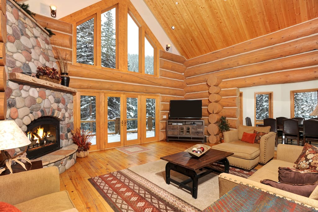 Features Flat Screen TV, Gas Fireplace and Doors out to Deck - open to Dining Area and Kitchen