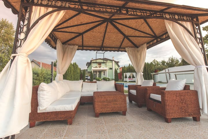 Our covered angled Sofa and two  armchairs next to the Outdoor Pool