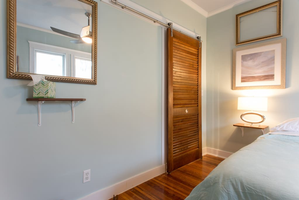 Sliding Asian-inspired doors to maximize the space.