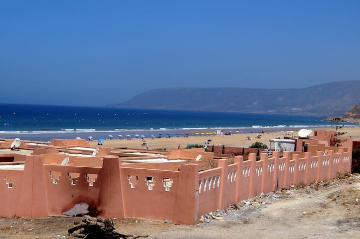 The beach and fish market in Imi Ouaddar - with Tiguert in the horizon