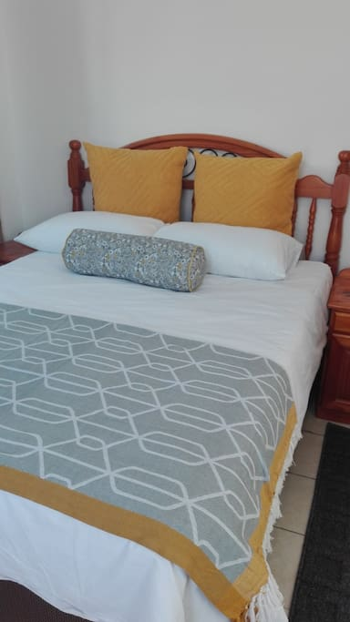 The double bed , high density mattress comfortably sleeps two with comfortable fresh bed linen.