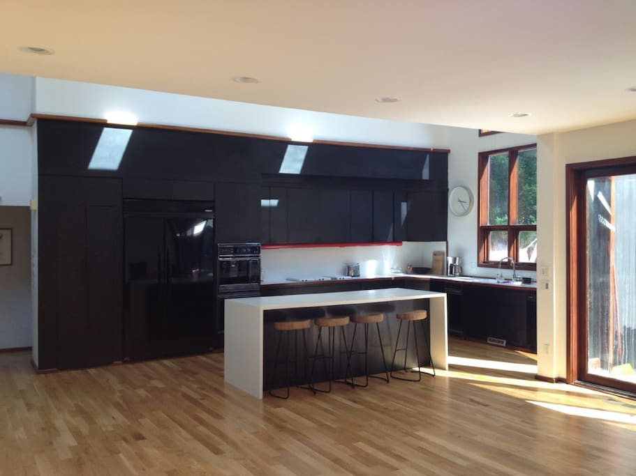 Open kitchen  with double height windows.