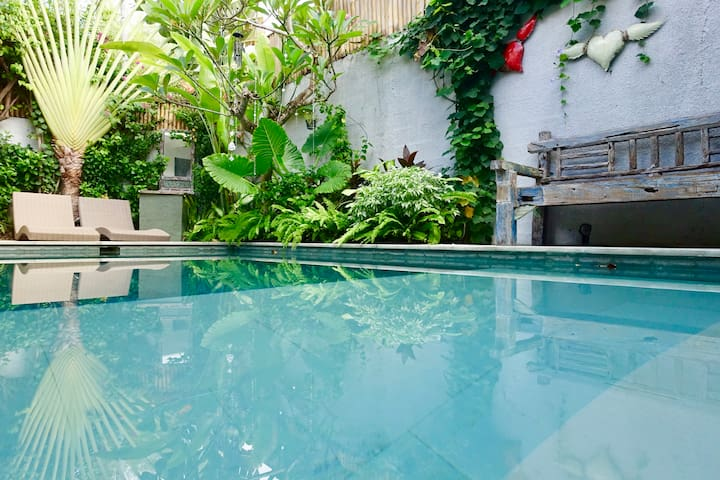 Sun-drenched, central pool..our 50cm out door Smart TV can be watched from the pool
