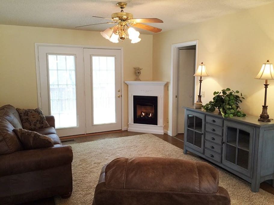 Cozy family room with comfy new furniture including a recliner.