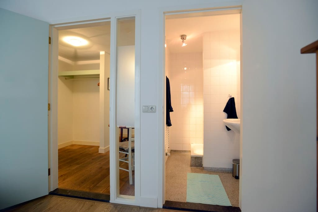 The bedroom leads to the spacious hallway and kitchenette and shows the separate shower facility. Toilet in the hall.