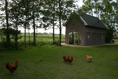 Koetshuis bij Biologische boerderij - Hiaure