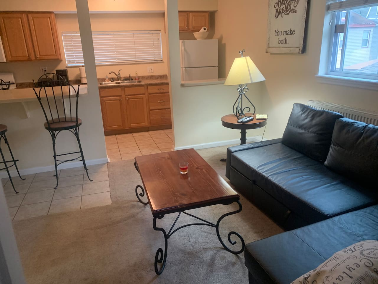 Living Room with sofa bed open to kitchen and kitchen breakfast/dining  area with 4 bar stools