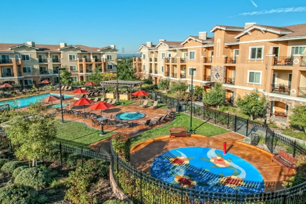 Resort grounds with pool, jacuzzi, and splash pad