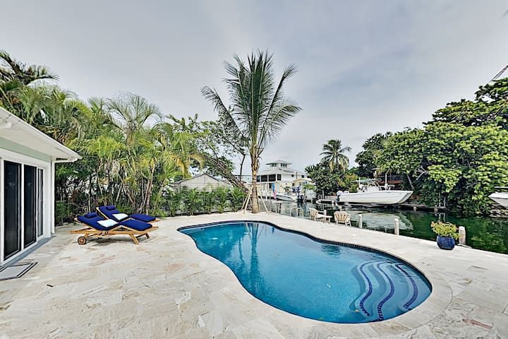 Canalfront Oasis with Pool, Dock & Outdoor Kitchen