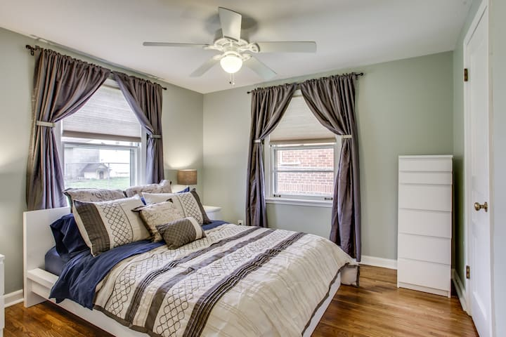 Relaxing and cozy bedroom with queen-sized pillow top mattress and extra memory foam topper.  There are cordless cellular shades on windows to let in lots of light and also black out curtains to allow you to sleep in.