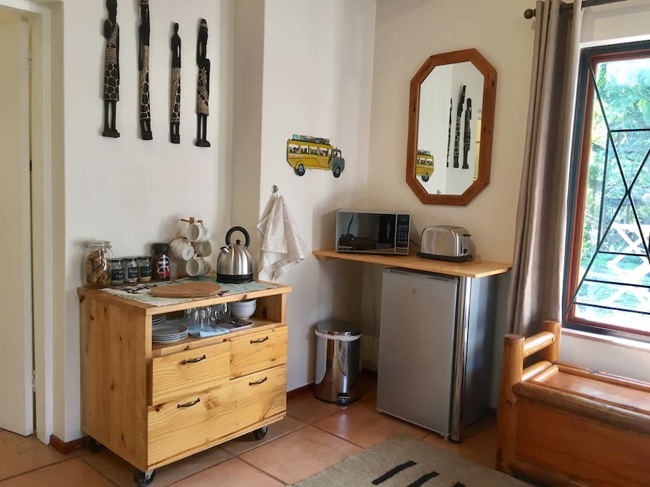 Small fridge, microwave, toaster, kettle and essential crockery, cutlery, wine glasses.