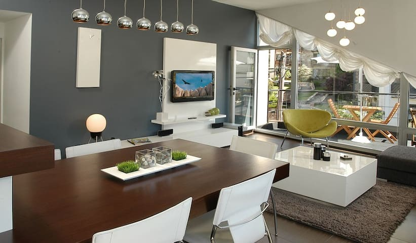Living/dining room with custom made furniture and mood lighting