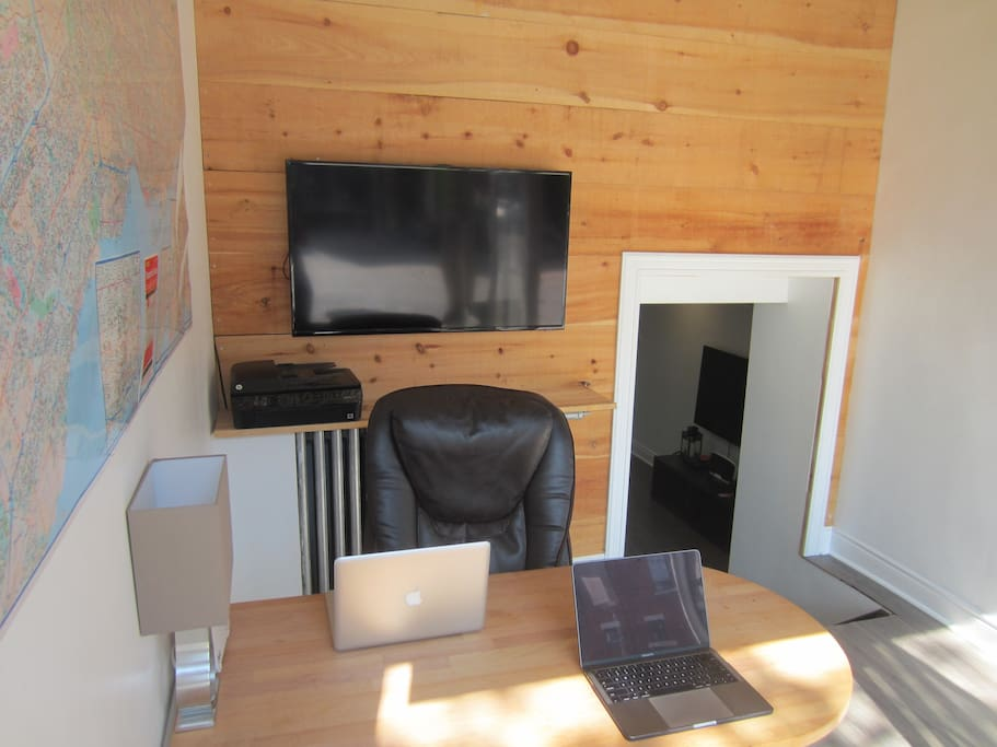 The front office space accommodates 3-4 people and provides a great work area. Print off any work or files or connect your laptop to the TV through the HDMI cord. The far wall features a large map of the city.