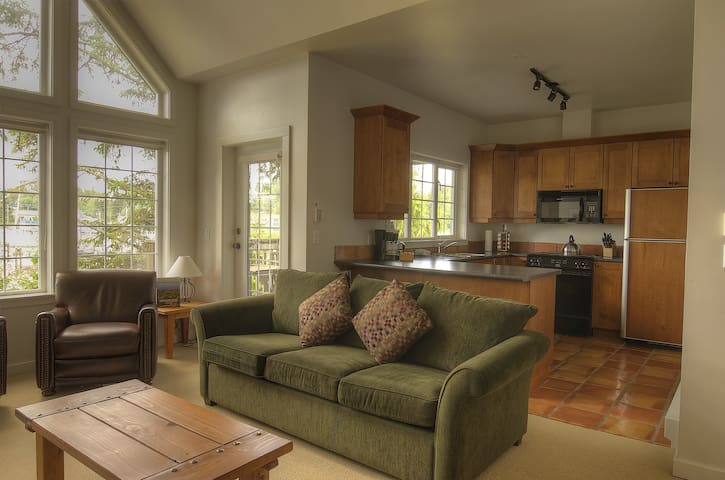 Vaulted Ceilings and large windows overlooking water views!