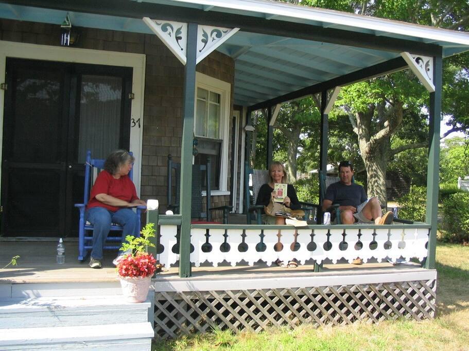 Enjoy our spacious porch.  Take a peek of the beach!