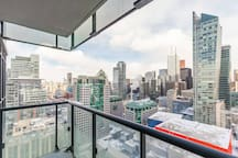 The balcony offers a stunning view of Toronto.