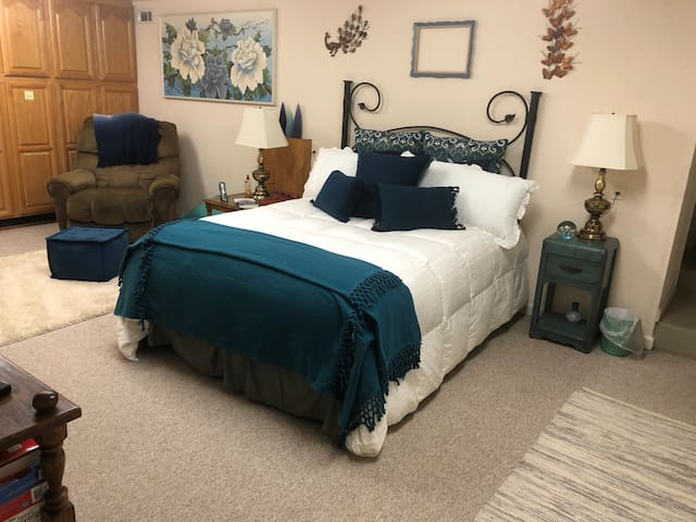 The spacious bedroom offers a Sealy queen mattress. There is also enough room to add an aero bed, if desired. The TV is equipped with Roku programming.