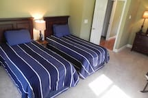 2nd bedroom features twin beds