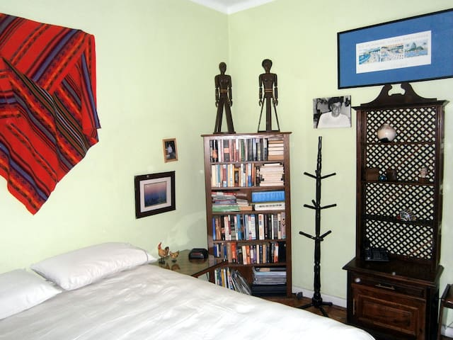 Clothes tree and shelves for your stuff.